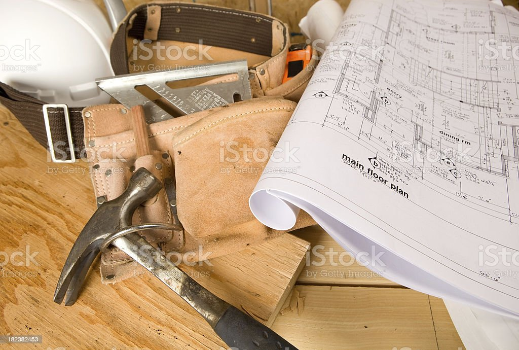 Construction Site with Plans, Tool Belt and Hardhat stock photo