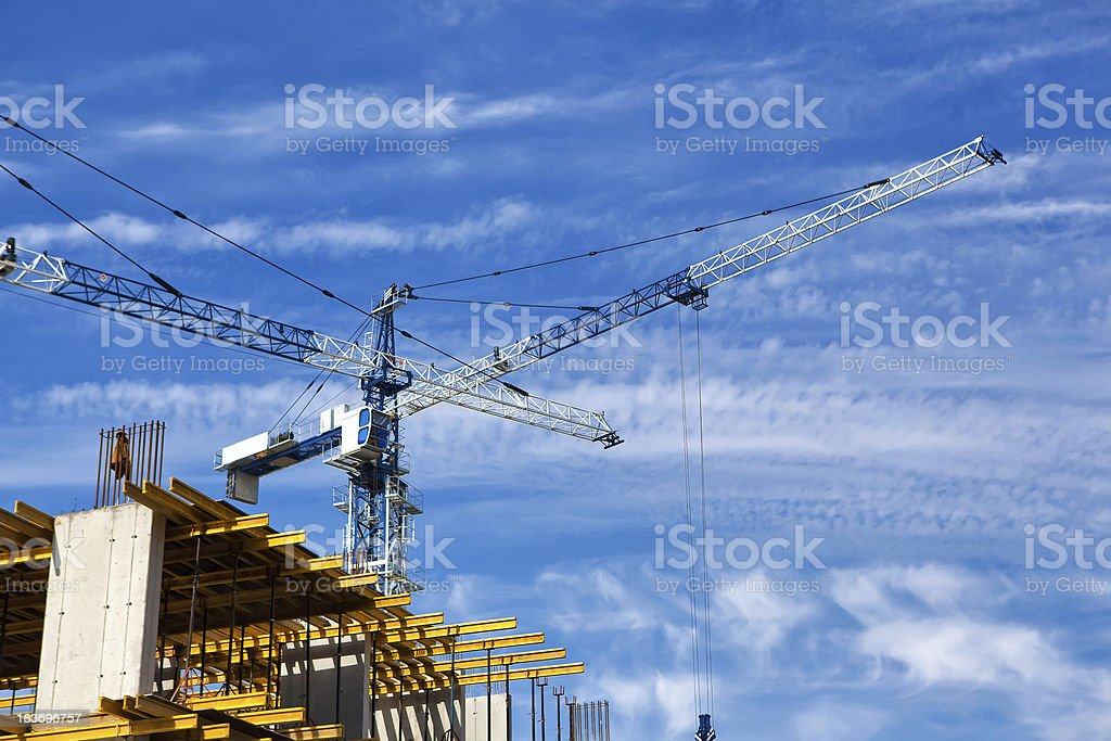 construction site with tower cranes royalty-free stock photo