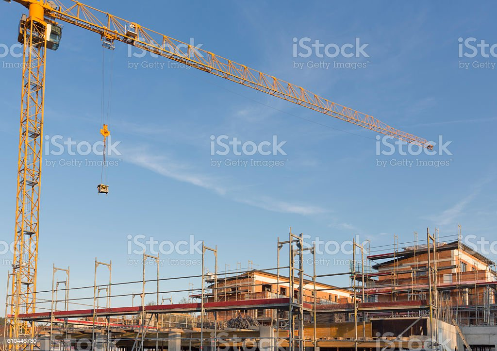 Construction site with yellow crane stock photo