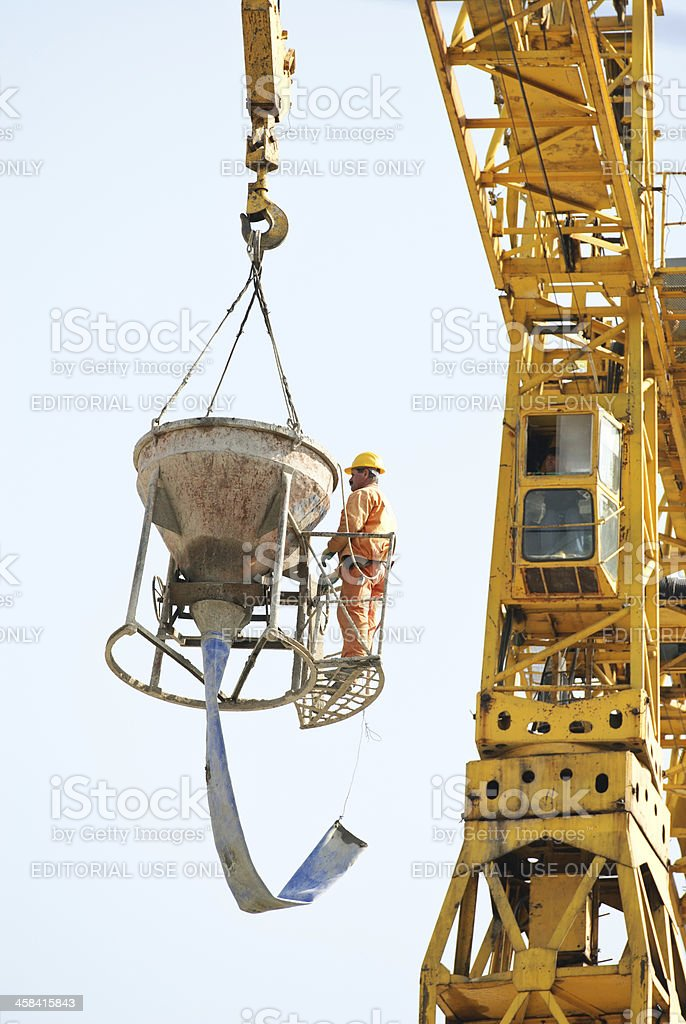 construction site worker high up stock photo