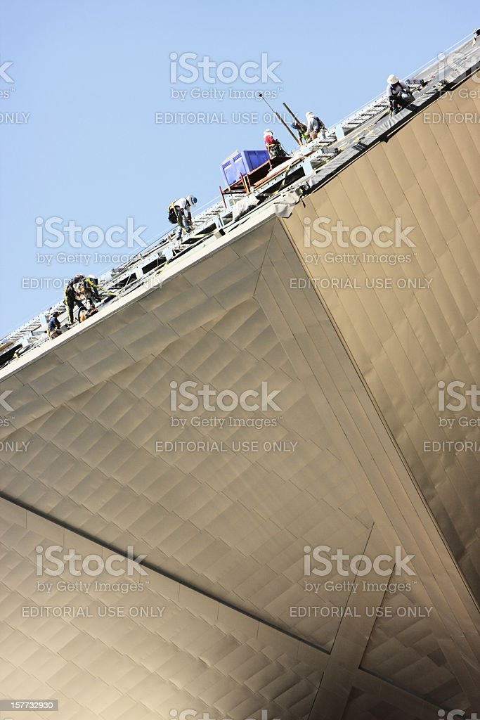 Construction Site Workers Repair Roof royalty-free stock photo