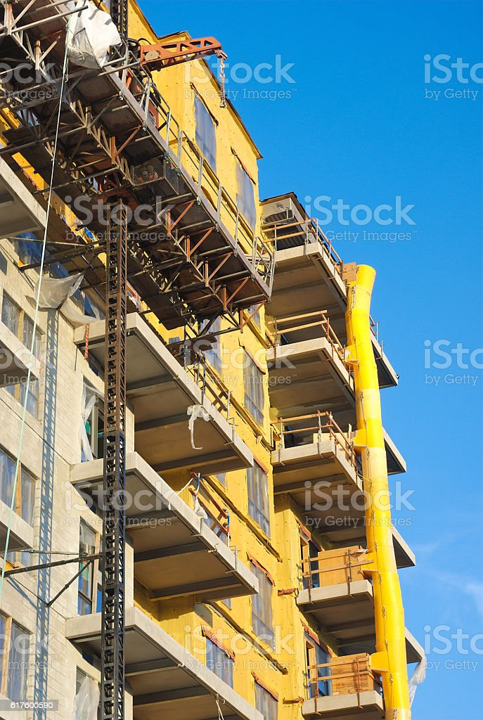 construction site yellow building insulation with downfall slide stock photo