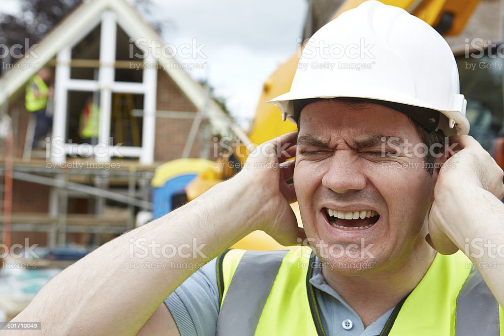 Construction Suffering From Noise Pollution On Building Site stock photo
