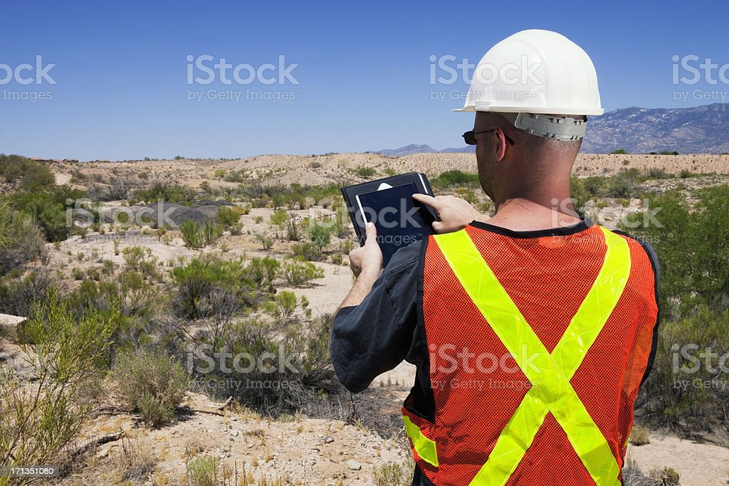 Construction Surveyor Using Tablet Computer royalty-free stock photo