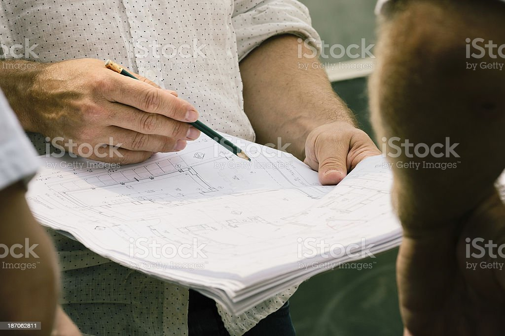 Construction team discussing plans royalty-free stock photo