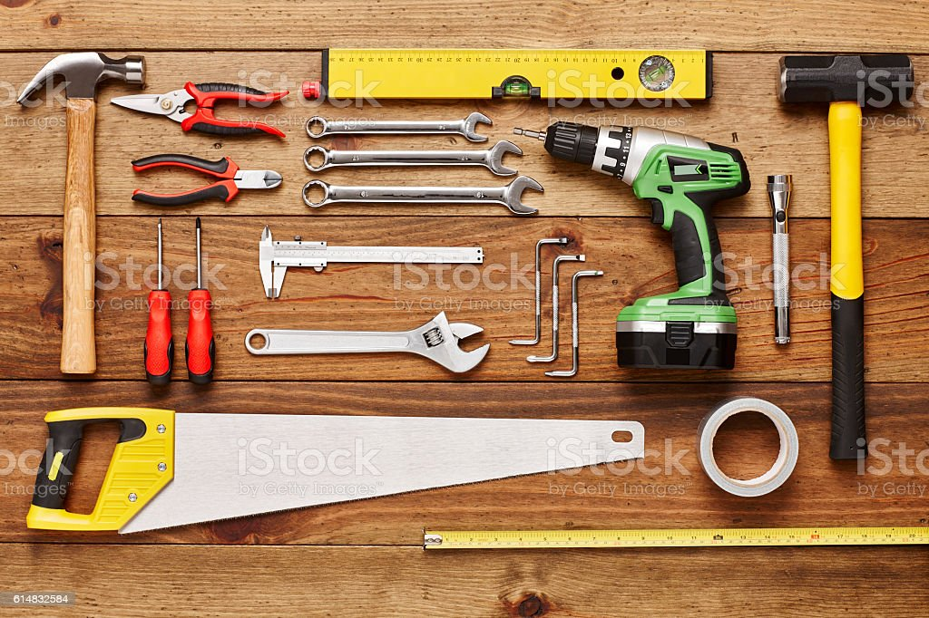 Construction tools are arranged on wooden floor - Knolling stock photo