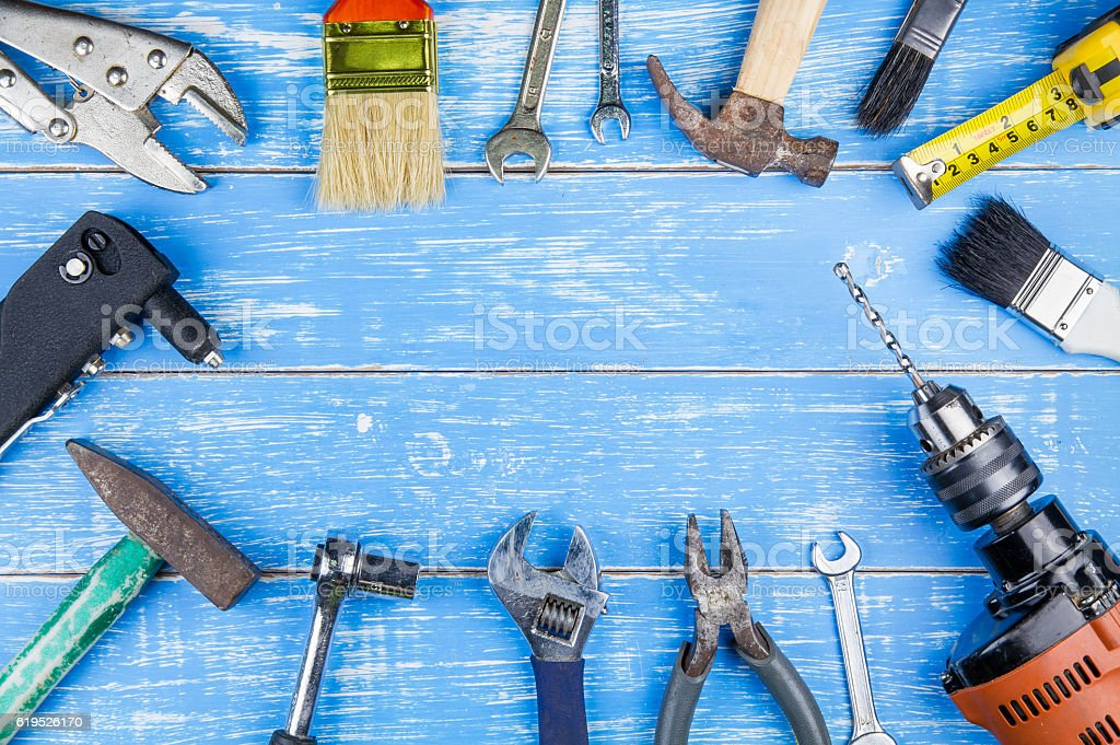 Construction tools on blue wooden table background stock photo