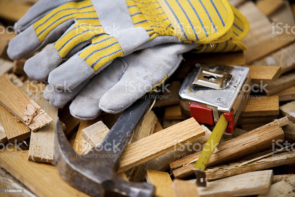 Construction Tools on Pile of Wood Background royalty-free stock photo