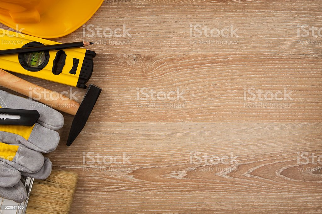 Construction Tools on Wooden Board stock photo