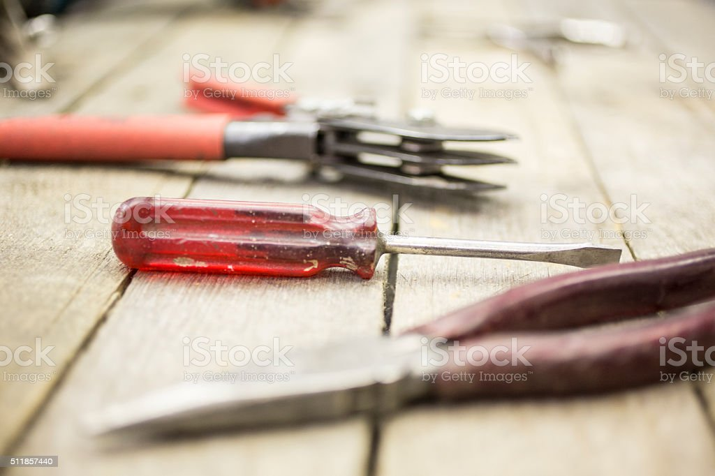 Construction tools on wooden desk. Pliers, screwdriver. stock photo