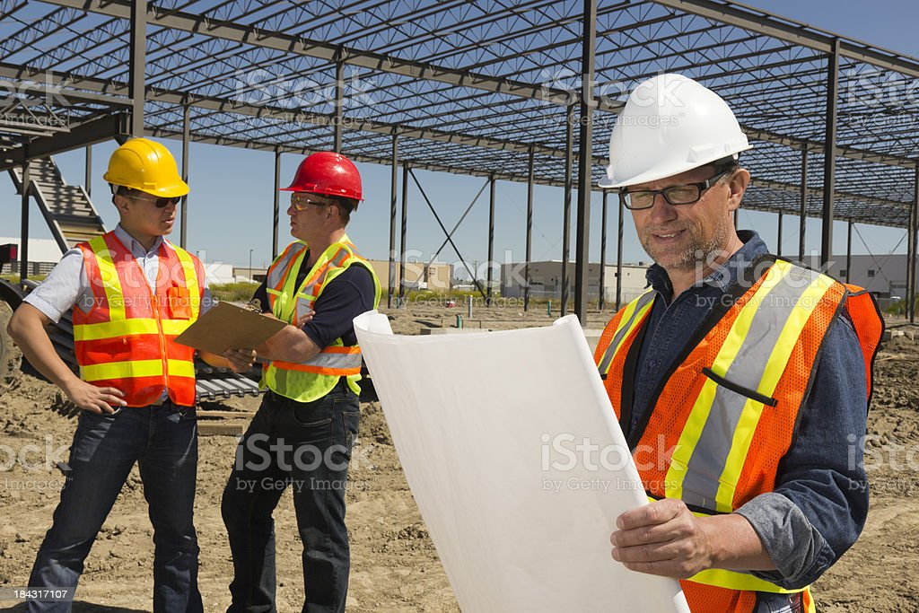 Construction Trio royalty-free stock photo