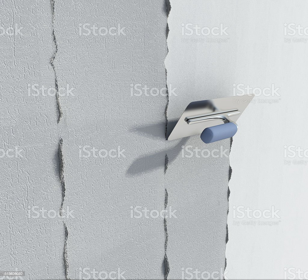 Construction trowel and wall with textured plaster stock photo