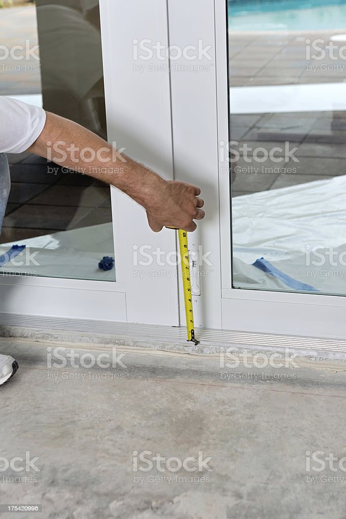 Construction- Using a tape measure stock photo