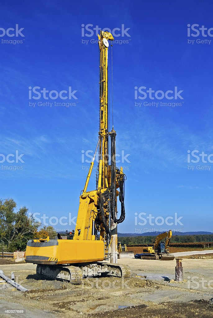 Construction vehicles during road building stock photo
