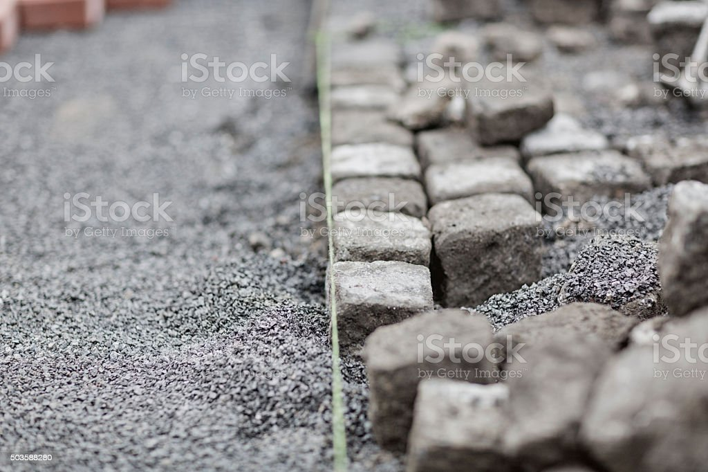 construction with pebble stones stock photo