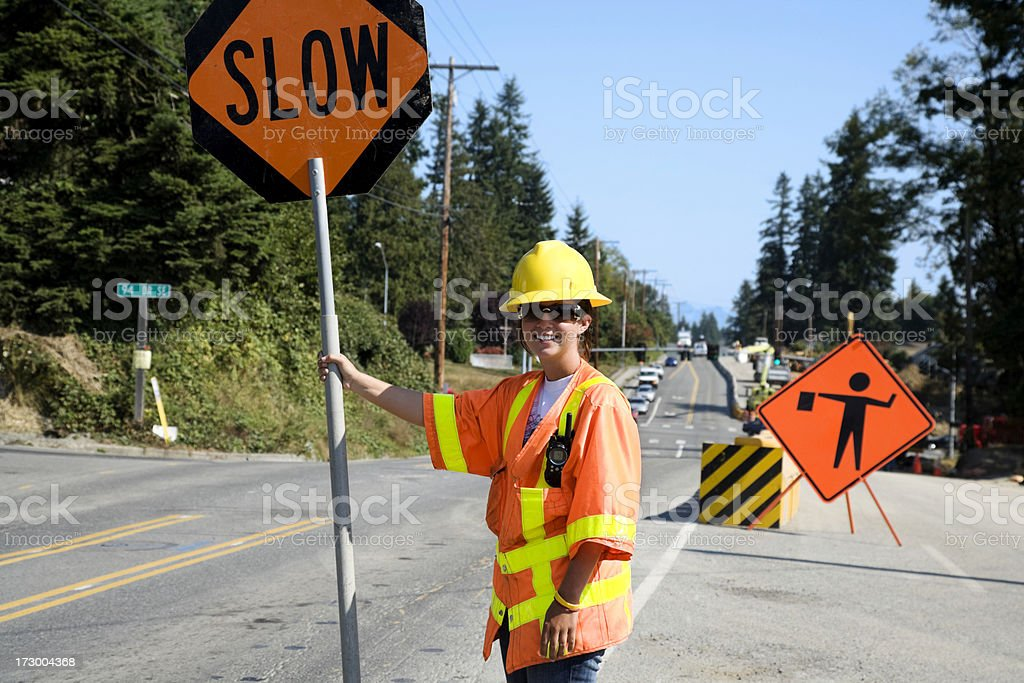 Construction Woman on the job site bright orange safety gear stock photo