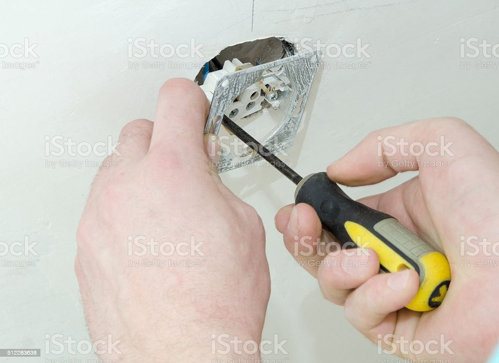 construction work, installation of the electrical panel in the wall stock photo