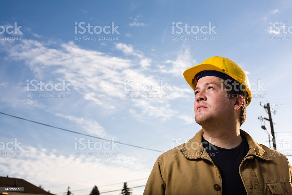 Construction Worker and Blue Sky royalty-free stock photo