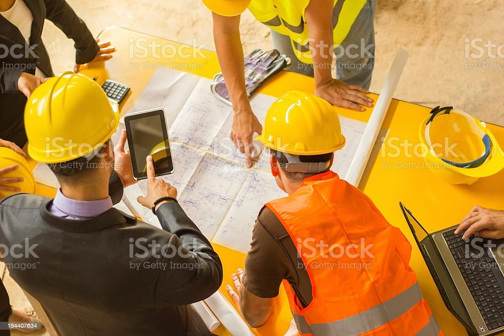 Construction worker and computer. stock photo