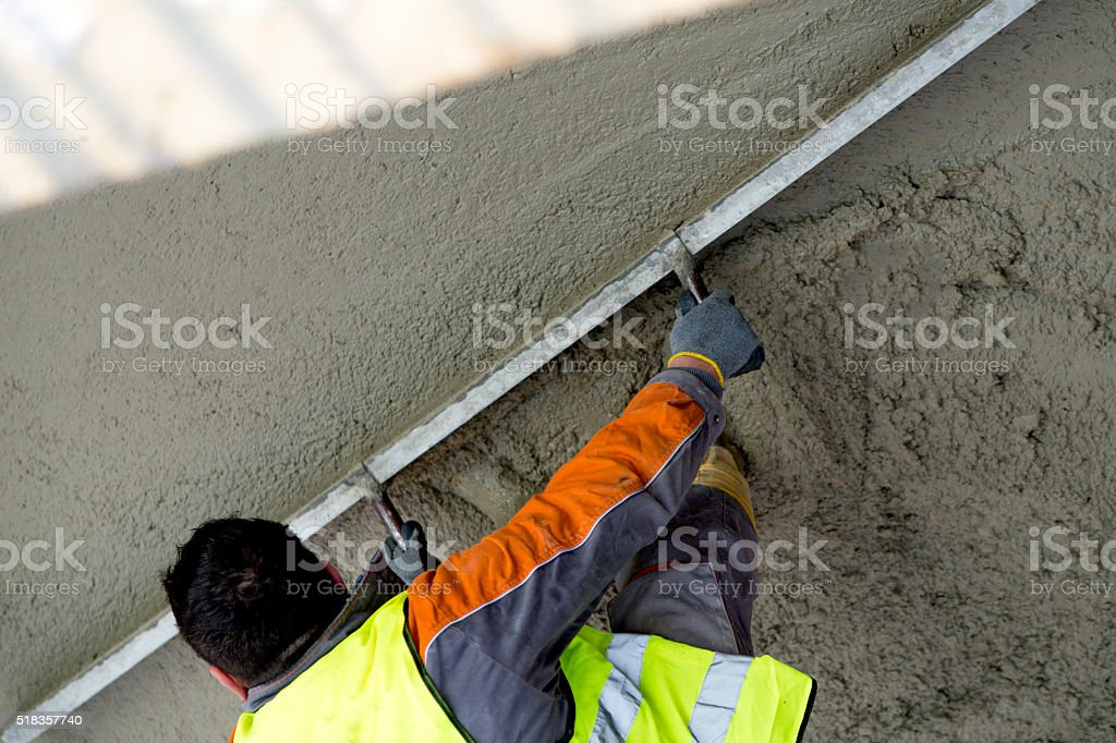 Construction worker and concrete stock photo