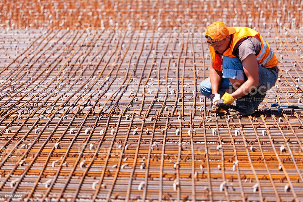 Construction worker and concrete reinforcement stock photo