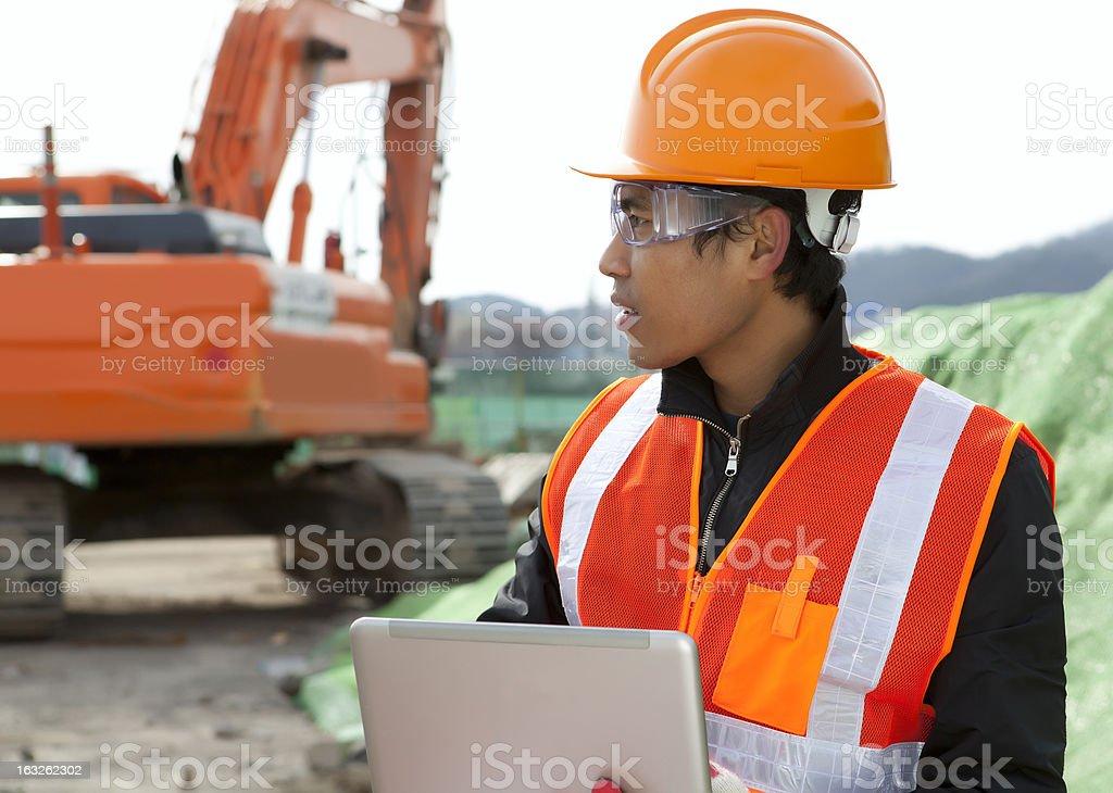 Bauarbeiter und excavator Lizenzfreies stock-foto