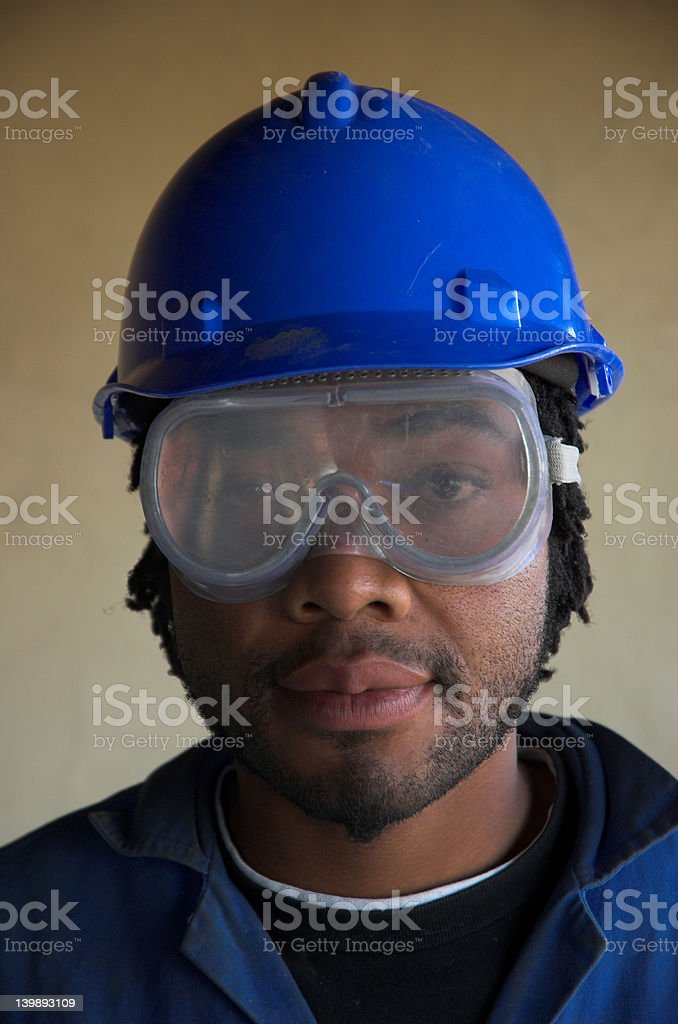 Construction worker and eye face mask royalty-free stock photo