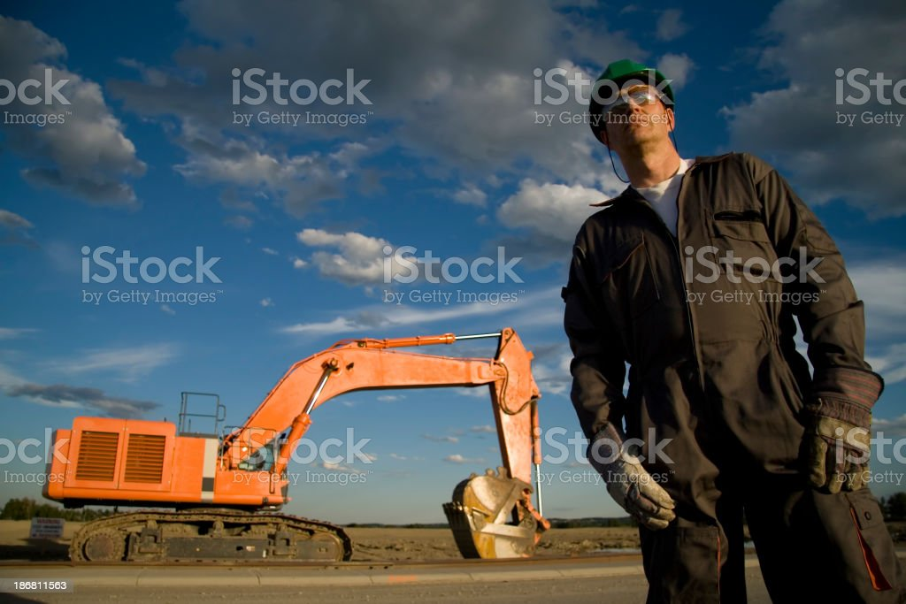 Construction Worker and Scoop royalty-free stock photo