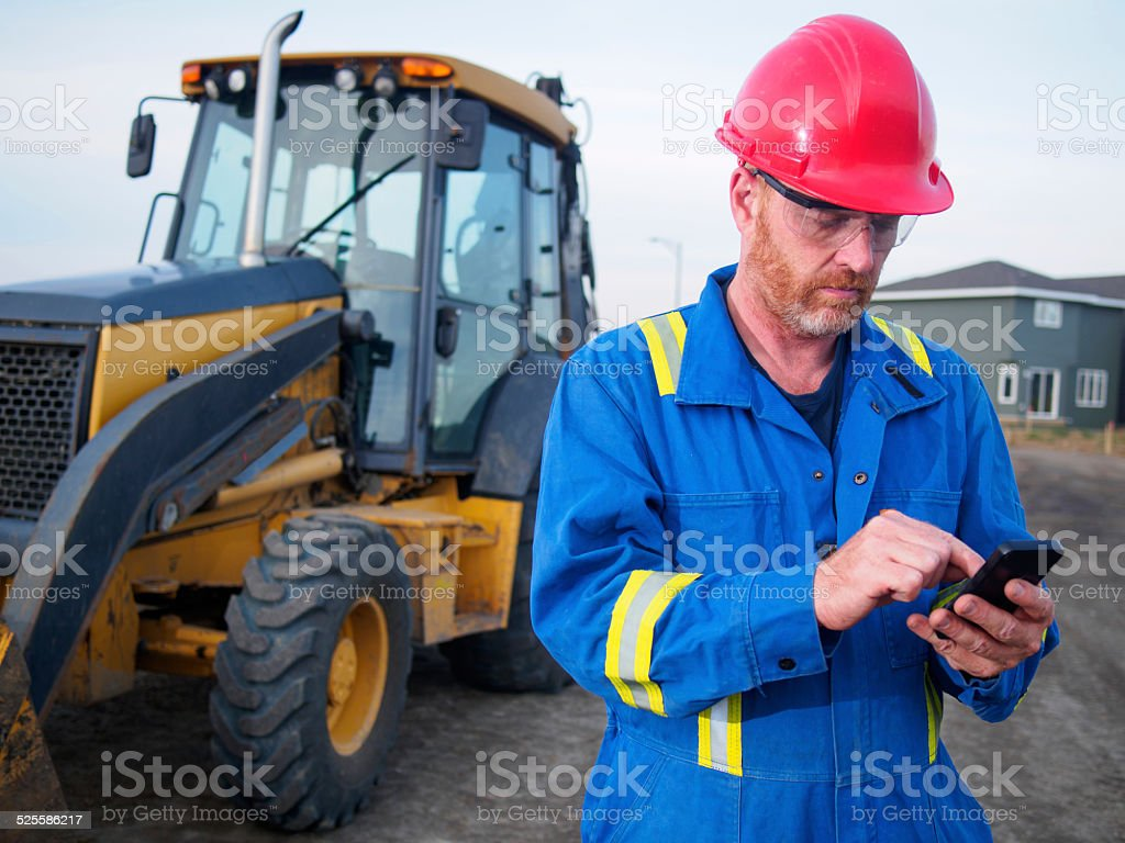 Construction Worker and Technology stock photo