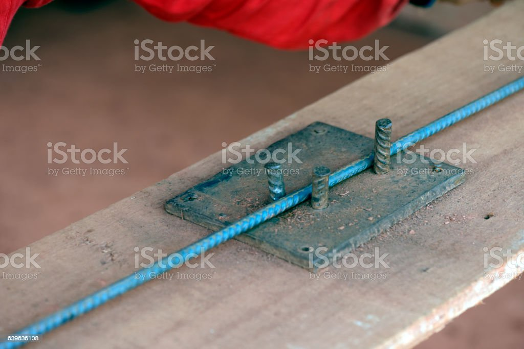 Construction worker assembling iron frame stock photo