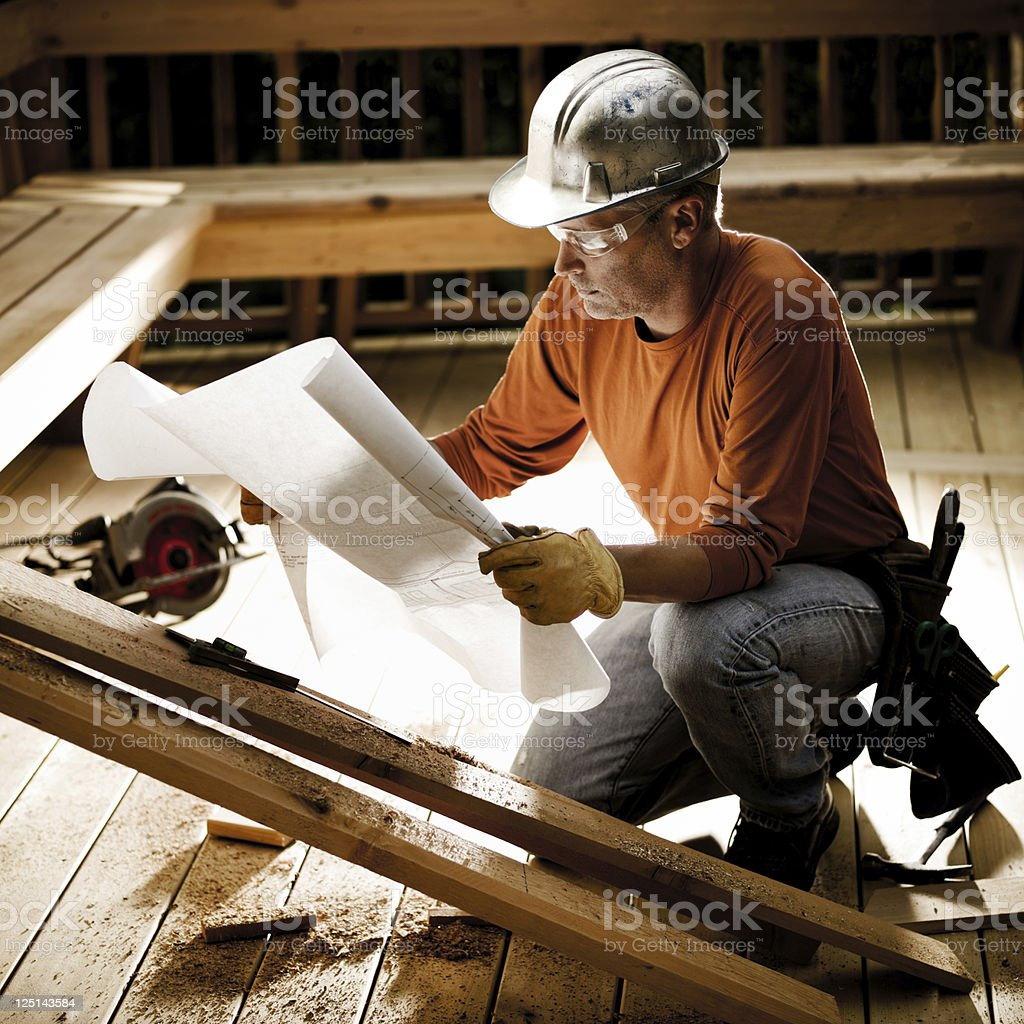 Construction Worker & Blueprints stock photo