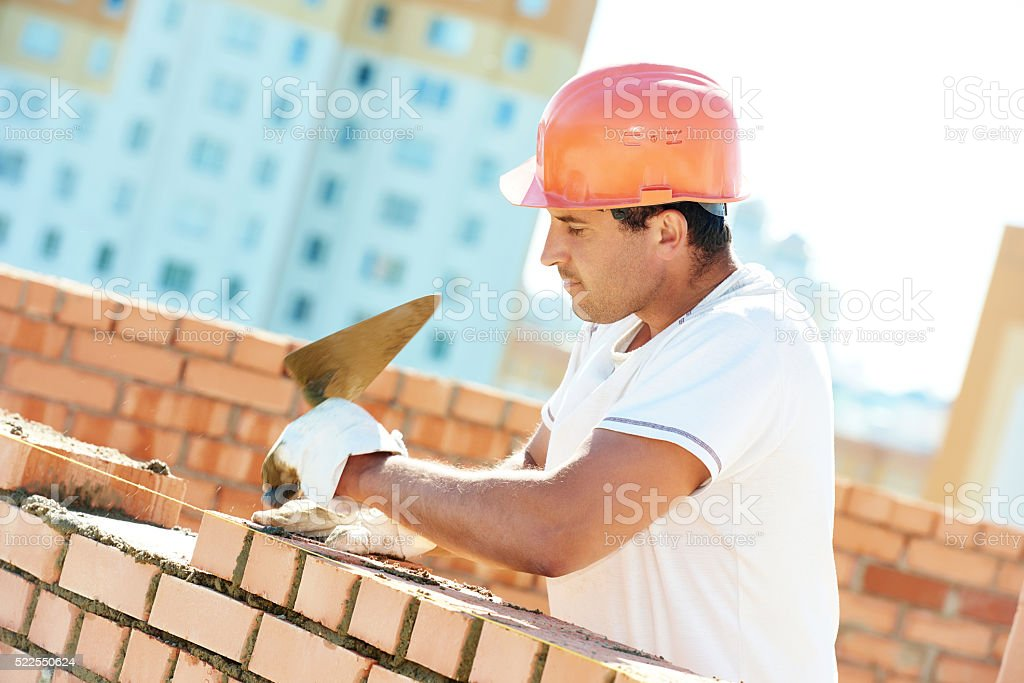 construction worker bricklayer stock photo