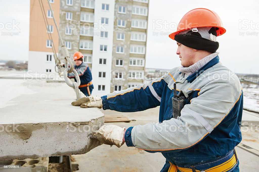 Construction worker. Builders concreter joiners at work stock photo