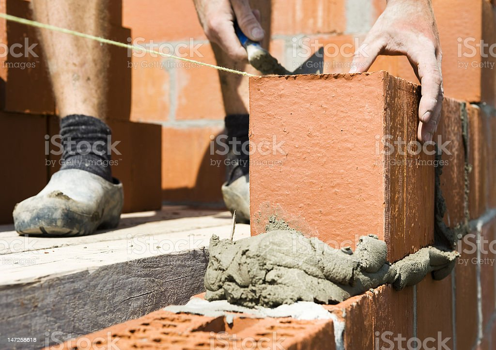 construction worker building a wall royalty-free stock photo