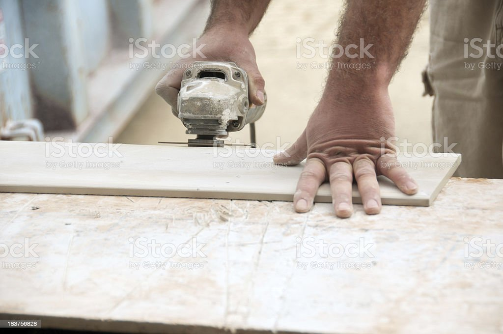 Construction Worker Bullnosing a Tile royalty-free stock photo