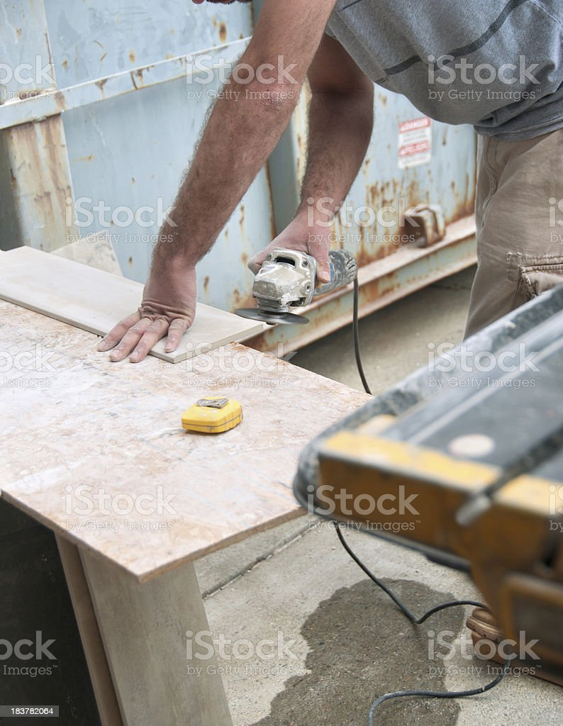 Construction Worker Bullnosing a Tile stock photo