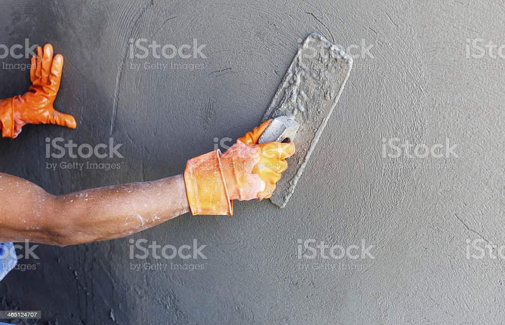 Construction worker by wall of house stock photo
