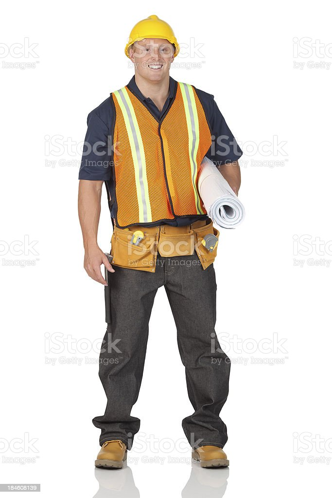 Construction worker carrying blueprint royalty-free stock photo