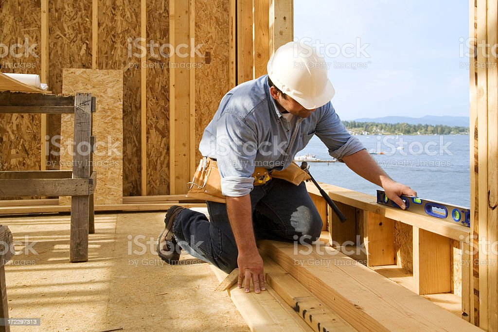 Construction Worker Checking Level royalty-free stock photo
