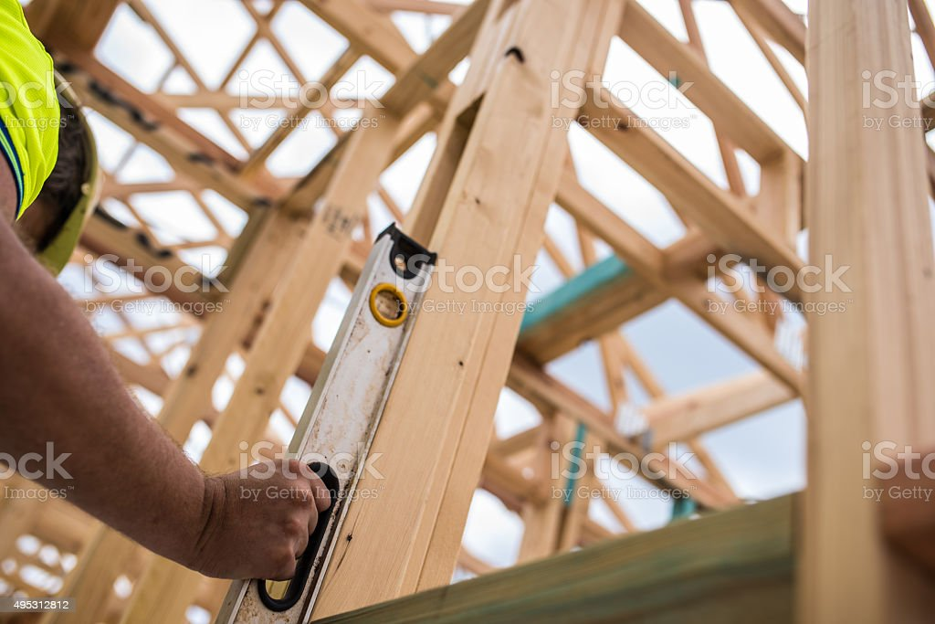 Construction worker checking level stock photo