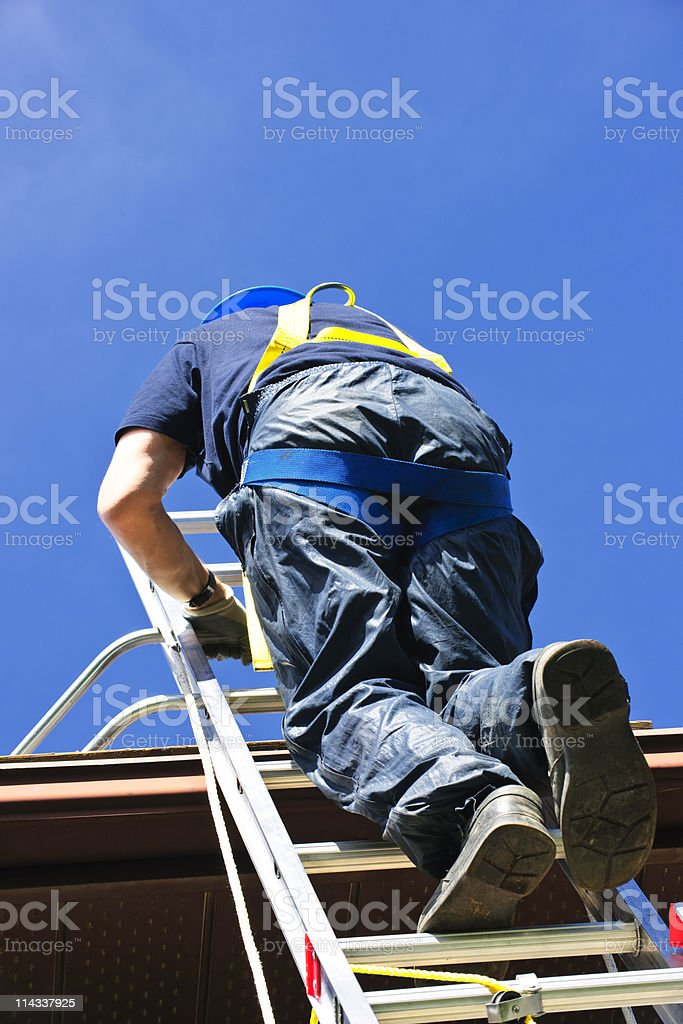 Construction worker climbing ladder royalty-free stock photo