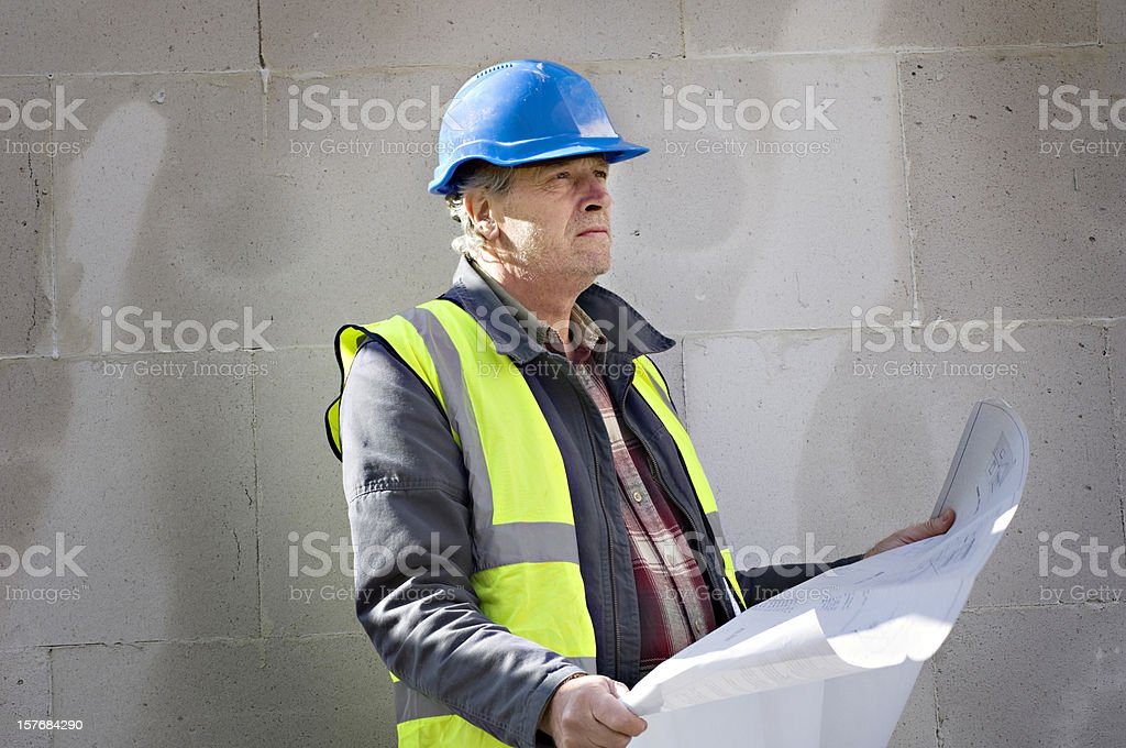 Construction Worker  Consulting Plans On Site stock photo