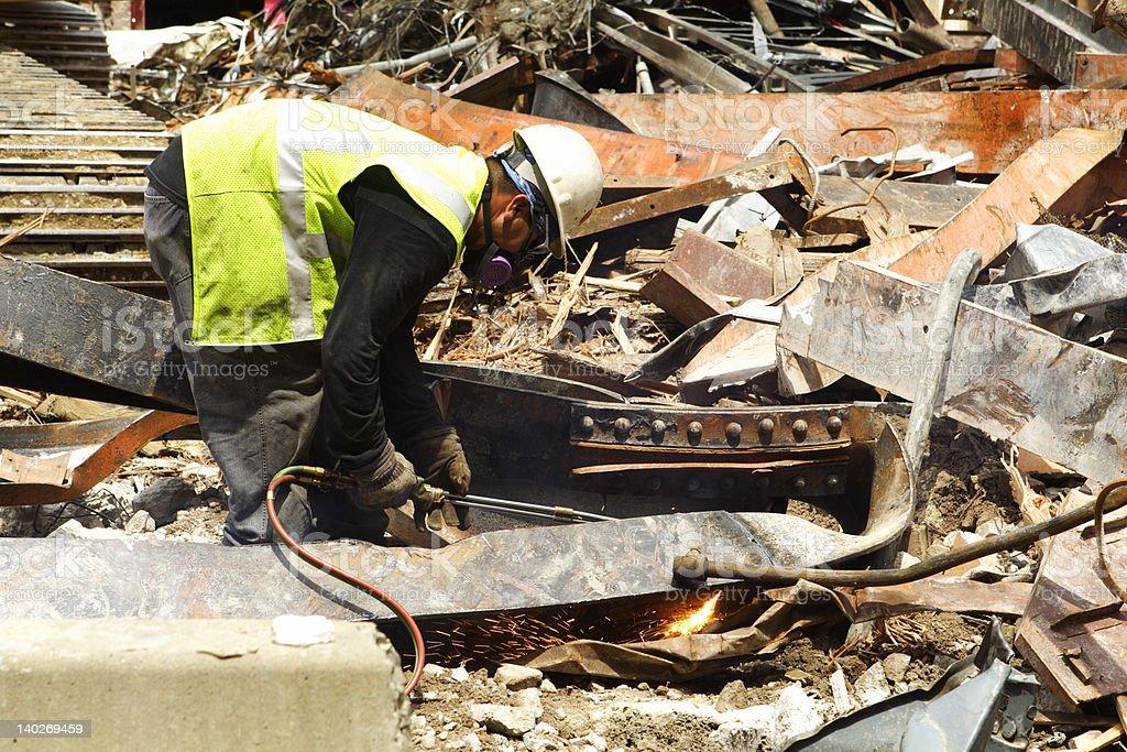 Construction Worker Cutting Scrap Metal Girder Building Demolition Site stock photo
