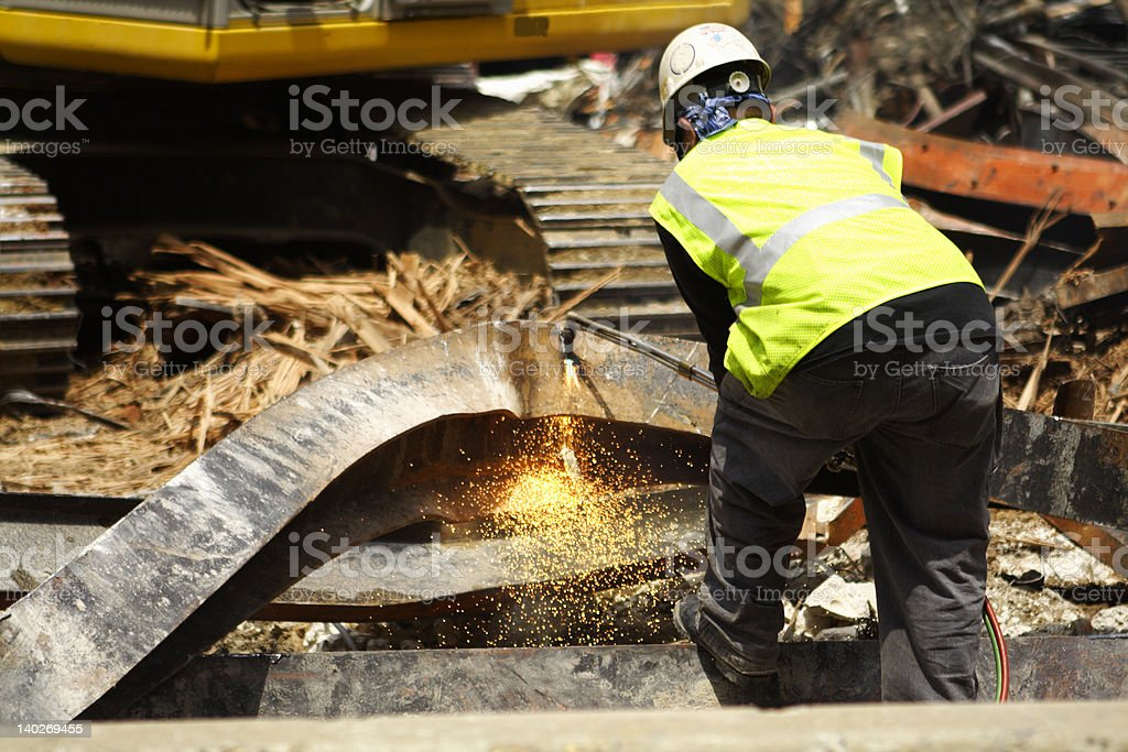 Construction Worker Cutting Scrap Metal Girder Sparks Building Demolition Site royalty-free stock photo
