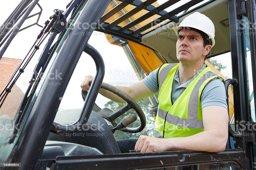 Construction Worker Driving Digger stock photo
