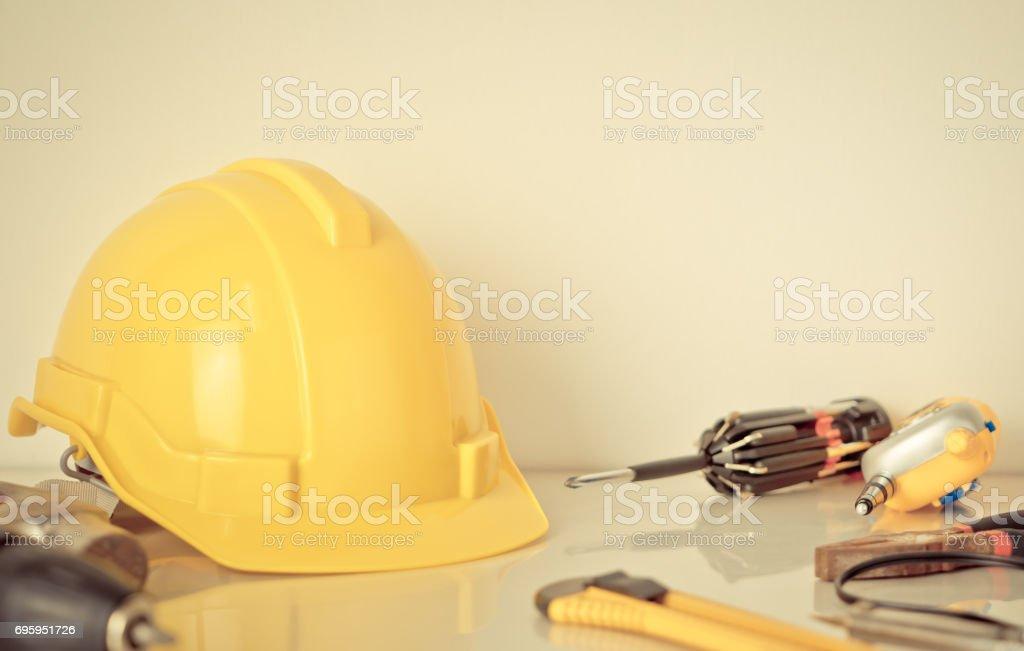 Construction worker equipment with helmet on white desk stock photo