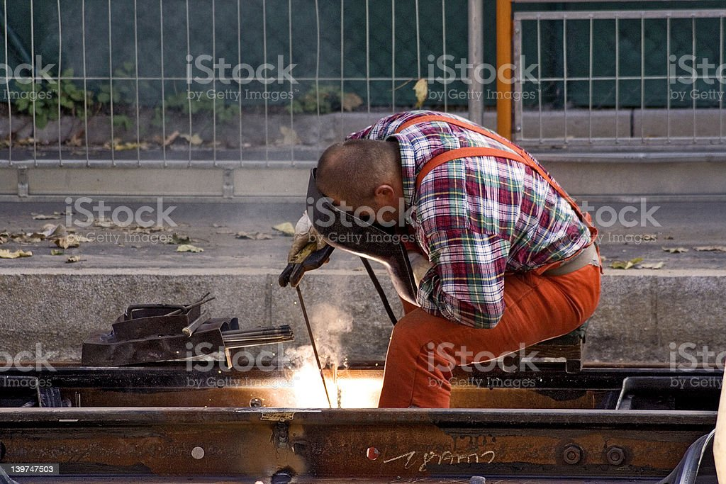 Construction Worker Fixing Rails (Horizontal View) royalty-free stock photo