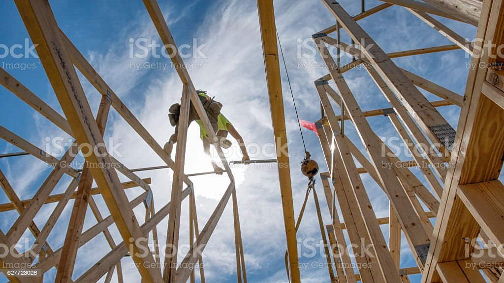 Construction Worker Framing A Building stock photo
