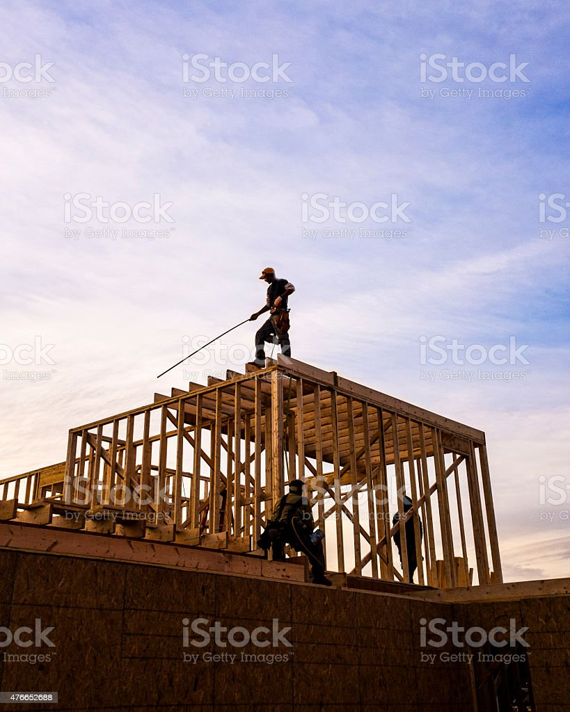 Construction worker framing a ho stock photo