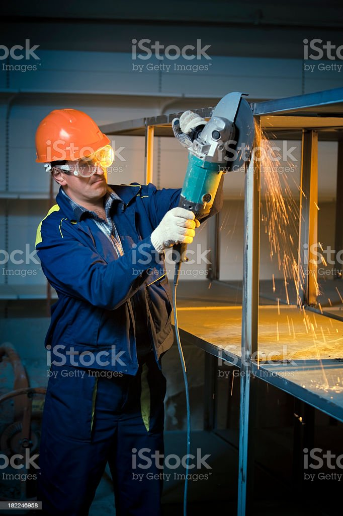 Construction worker grinding welds stock photo